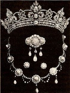 Queen Victoria's son, the Prince of Wales (known in the family as Bertie), married Princess Alexandra of Denmark in 1863. The future King Edward VII gave his wife an impressive start to her jewel collection: a parure of a diamond tiara with a pearl and diamond necklace, brooch, and earrings.
