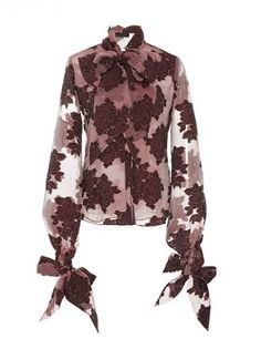 We love the velvet detail on this chic blouse - not to mention the fun bow sleeves!