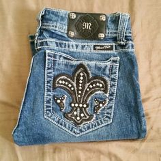 Miss me jeans size 29x34 Great condition except for a few holes on bottom. Shown in pics. Size 29x34. Feel free to make offers Miss Me Jeans Boot Cut