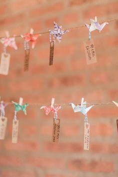 DIY paper crane escort cards: http://www.stylemepretty.com/2015/02/18/urban-chic-chicago-loft-wedding/ | Photography: T&C - http://www.tandcphotographie.com/