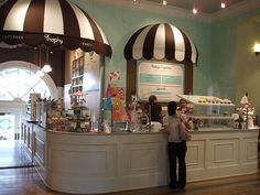 Love the awnings, the moldings around the counter and the color combination of white, brown, and aqua blue