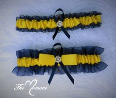 Beautiful Keepsake garter as well as a Toss-away garter in Navy Blue Organza and Yellow Satin accented with a sparkling rhinestone brooch. These garters are made from quality fabric and ribbons. Relax