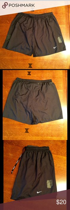 Nike running shorts. Nike running shorts in size medium.  Dri-fit fabric technology.  Brief inserts.  Mesh inserts for breathability.  Zippered pocket on back of shorts.  29 inch waist and 5 inch inseam.  Lightweight fabric, 100% polyester.  Shorts have been worn but are in excellent condition. Nike Shorts