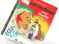 Vintage childrens book, Winnie the Pooh meets Gophter, is a Little Golden Book story, adapted by George Desantis from the A.A. Milne story