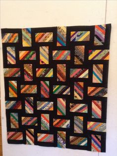 String Quilt, I like the look but looks unfinished, would put a solid black border on it.