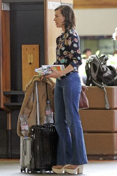 Milla Jovovich looking stunning as she arrives in Hawaii with her family to bring in the New Year.