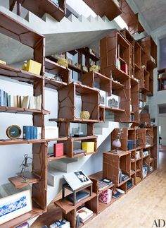 The spine of the three-story house is a staircase that incorporates a leather-wrapped bookcase | archdigest.com