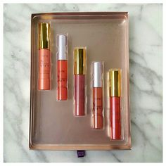 Tarte LipSurgence Gift Set Set contains three full size LipSurgence Lip Cremes in Decadence, Adorned, and Regal; and two LipSurgence Lip Glosses in Fearless and Exposed. New in gift box. tarte Makeup