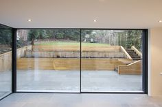 www.iqglassuk.com Minimal Windows Sliding Doors to rear of residential property that slide into pocket to the right.