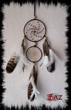 Dreamcatcher with buzzard feathers and hematite beads #dreamcatcher #hematite https://www.facebook.com/pages/Des-Noeuds-et-des-Pierres/598136326891842