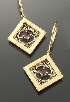 "Earrings | Marie Scarpa.  ""Woven Squares"".  14k yellow gold with garnets"