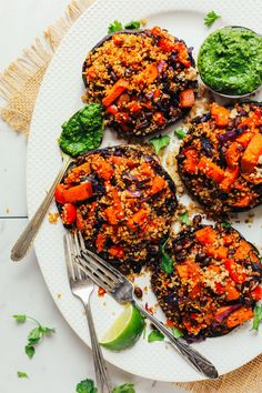 Quinoa, black bean, and vegetable stuffed portobello mushrooms with chimichurri sauce! A hearty, wholesome 30-minute plant-based meal.