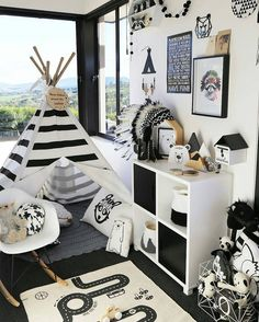 I love how striking this room is absolutely no holding back on a strong monochrome theme here! The OYOY Adventure Rug looks amazing along with all of the other cool black and white items from some fabulous brands.