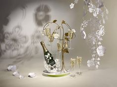 Emile Gallé's anemones inspired Tord Boontje to design a tree with flowing lines blossoming with anemones… and flutes. Please Drink Responsibly