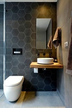 Pin This stunning bathroom features charcoal hexagon tiles and large rectangle concrete look porcelain tiles. The hexagon tiles add texture and warmth to the space. The Block Bathroom, Downstairs Bathroom, Laundry In Bathroom, Bathroom Wall, Floating Bathroom Sink, Floating Toilet, Floating Vanity, Bathroom Layout, Bathroom Ideas