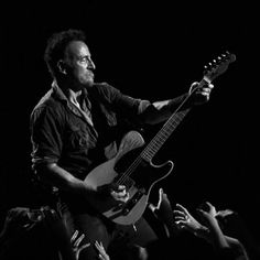 Exclusive, limited edition print of Bruce Springsteen and his Telecaster. Cynthia Woods Mitchell Pavilion, Houston, Texas, 2014.