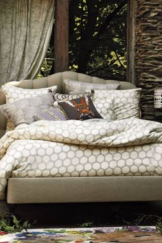 Tosi Duvet - anthropologie.com The spots could be a gorgeous contrast to the patterned sheets. $200+