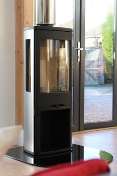 Contura 750A, modern Wood burning stove clad in aluminium.