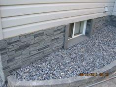 Goodbye, ugly foundation! (Faux stone panels from NextStone.)
