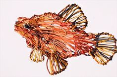 #Fishbrooch #Metalwireart #OcanFish jewelry #Tropicaljewelry #Seaart sculpture womens #colorful jewelry Orange jewelry #StatementbroochThis handmade orange fish brooch colorful jewelry is an art, modern statement brooch ocean fish tropical jewelry made of colored copper and silver wire. The height of the metal wire art fish, sea art brooch is 3.5cm (1,38in), and the width is 5.5cm (2,17in) The pin of the wire art sculpture Womens gift jewelry fish brooch is bronze. Very easy and safe to…