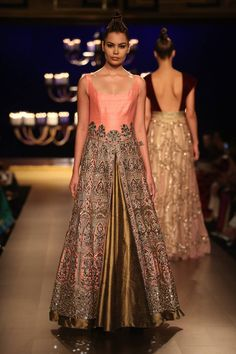 """India Couture Week 2014 - MANISH MALHOTRA """"It has a very old world charm...old world, intricate embroidery. It took a lot of time. A lot of pieces took in-house hand embroidery work of about three to four months. I thought that the whole take was modern. And by the title, we were talking about portraits which are really timeless. Tonight is one such timeless moment. It's the first time Aditya Roy Kapoorand Alia Bhatt are coming together."""", said the designer Manish Malhotra"""