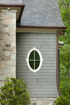 Shingle home with oval window. Interiors by Mary McWilliams from Mary Mac & Co. Cottage Exterior, Exterior Trim, House Paint Exterior, Exterior Paint Colors, Exterior House Colors, Paint Colors For Home, Exterior Design, Interior And Exterior, Beach Cottage Style