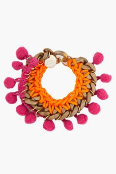MATTHEW WILLIAMSON //  POM POM CHAIN BRACELET  21307F080001    Metal and textile bracelet in bronze tone, neon orange and purple. Pom poms at edge. Embossed logo plate at pull-clasp closure. Approx. 6'' length. 50% metal, 50% textile.  $285.00 USD
