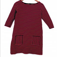 Tommy Hilfiger Dress This tunic shirt is navy and red. Has a boat neck top and has two pockets on the bottom. This would be a pretty short dress but a perfect tunic with spandex. Has been worn but in good condition. Tommy Hilfiger Dresses Mini