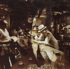In Through the Out Door Led Zeppelin http://www.amazon.com/dp/B000002JSP/ref=cm_sw_r_pi_dp_AKmxvb0FP9P5M