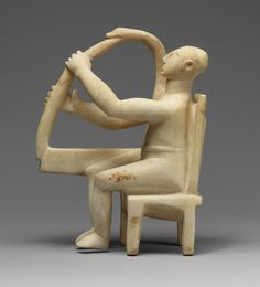 "Cycladic sculptures [Greece] ~ ""Seated harp player"". Late Early Cycladic I – Early Cycladic II, 2800/2700 B.C. Marble. (29.21 cm). The Metropolitan Museum of Art, New York. 