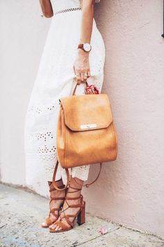 Jess Kirby wearing the Brahmin Southcoast backpack with lace up heels and a  white dress Warm 32462c96d721b