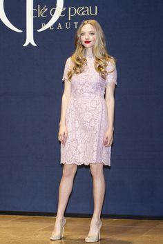 Cle De Peau Beaute press conference , Seoul – December 4 2013  Amanda Seyfried in a Valentino pink lace dress.