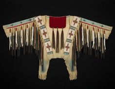 This War Shirt's shape was inspired by an 1860's shirt in the Hirschfield collection. Materials: Deer hide, seed beads, trade beads, red trade cloth, horsehair, ermine tubes, and red, blue, and black
