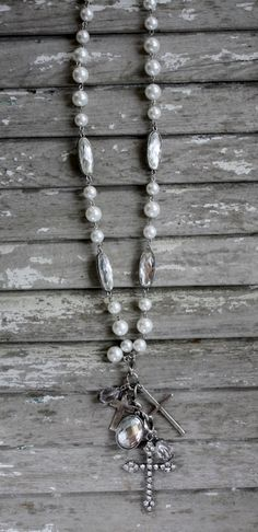 Long Strand of Pearl Beads with Crystal Cross Dangle www.gugonline.com