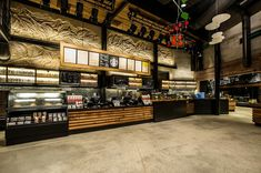 Starbucks Downtown Disney Orlando - Shot of our front line. Reclaimed wood, raw concrete, hot rolled steel and art create a dramatic stage for our guests.