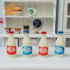 Find More Furniture Toys Information about New1:12 Dollhouse Miniature  Kitchen  Furniture Accessories  Food 4PCS Milk Bottles Model  Food Toy  Free Shipping,High Quality miniature kitchen furniture,China miniature kitchen Suppliers, Cheap dollhouse miniature kitchen from Dream dollhouse on Aliexpress.com