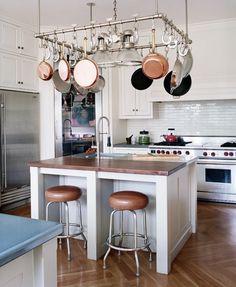 Copper Pots. Bar stools. Chevron wood floors. Tile backsplash.   Design byC.W. Eisner