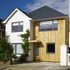 A full eco refurbishment of a 1960s detached house in Brighton. This project saw the carbon footprint of the house reduced by 77% from 10.9 tonnes per year down to 2.5 tonnes. This 1960s detached house has been fully insulated (including an external insulating render) and had 3 heating systems installed including a condensing boiler feeding the under floor heating, ... Read More