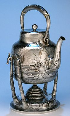 Dominick & Haff Japanesque Sterling Silver Coffee & Tea Service, 1881.  The handles are executed in a basket weave design and the bodies decorated with wildlife and aquatic scenery.Both the kettle and coffee pot feature 2 large dragonflies in flight above pools of flowing water and exotic plants.