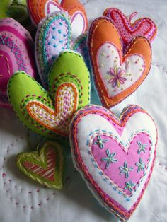 embroidered hearts  OMG, so, so cute!!!!  Have felt, could do something like.  Love these for decorations, like X-mas tree, wrapping presents, stringing many together for a wall hanging, so many ideas....