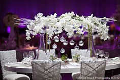 White on white wedding reception decor. LOVE everything about this tablescape. The linear centerpieces, the silvery sparkle chair covers. Would look amazing on a long table! Wedding Reception Decorations, Wedding Centerpieces, Wedding Table, Centerpiece Rentals, Modern Centerpieces, Reception Table, Orchid Centerpieces, Rose Design, Floral Design