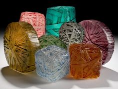 Recycled glass rubberband balls and cubes by Erwin Timmers. Glass fusing is a process of layering and then putting the glass into a kiln at temperatures around 1500°F (not enough to completely melt it). www.ecoglassart.com