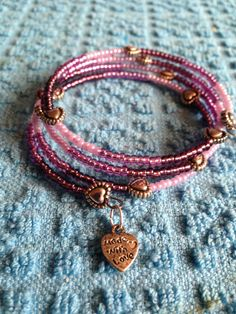 Seed beads & copper charms - Beaded memory wire bracelet on Etsy, £5.00