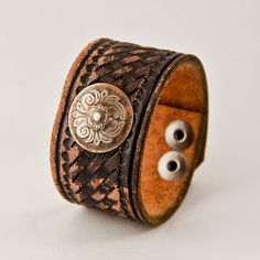 Lots of beautiful handmade pieces available at this shop! Check it out!    Jewelry Bracelet Cuff Hand Tooled Leather, Western, Southwestern, Rustic, OOAK $49.75 USD     Only 1 available at shop: rainwheel