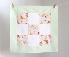 """Adding a border to a quilt block is a great way to add a little variety to your quilt tops. It's also a great way to increase the size of a quilt block to turn it into a placement, tote bag, or pillow. :DBest of all? Adding a border to a quilt block is super easy and you can make it look anyway you want!If you'd like to learn how to quilt, I have a full step by step tutorial! Check out """"how to sew a quilt"""" for more information."""