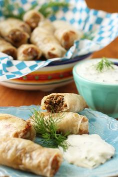 An easy peasy method for making BAKED GLUTEN FREE SAUSAGE ROLLS using rice paper wrappers! Delicious with a tangy Greek tzatziki sauce. Great to have on hand for school lunches or entertaining, or picnic weather ahead!