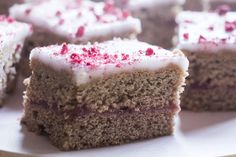The mixed spice and cinnamon give this bake a lovely warm spice flavour and deep colour. Belgian square is sweet, so keep the layers of jam and icing as thin as possible. Cut into small squares. If you can't get freeze dried raspberries, ice with a pink icing using a little frozen raspberry juice or use plain white icing sharpened with lemon juice. You could also top the icing with raspberry powder.