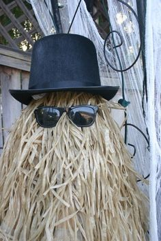 dollar store hula skirts, hat glasses! use tomato cage for shape  STARSHINE CHIC : Happy Halloween