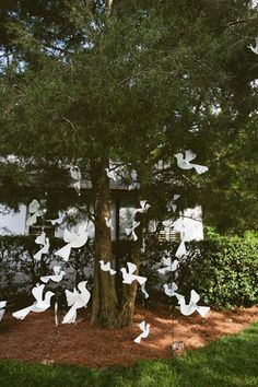 I like the paper birds but would choose a more elegant graceful looking bird pattern Real Weddings: Courtney & Michael's Poolside Wedding