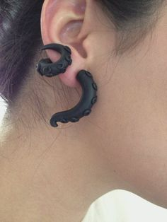 These are so weird, but I kinda like them... Wrap Around Octopus Earrings by Pyxy on Etsy, $12.00